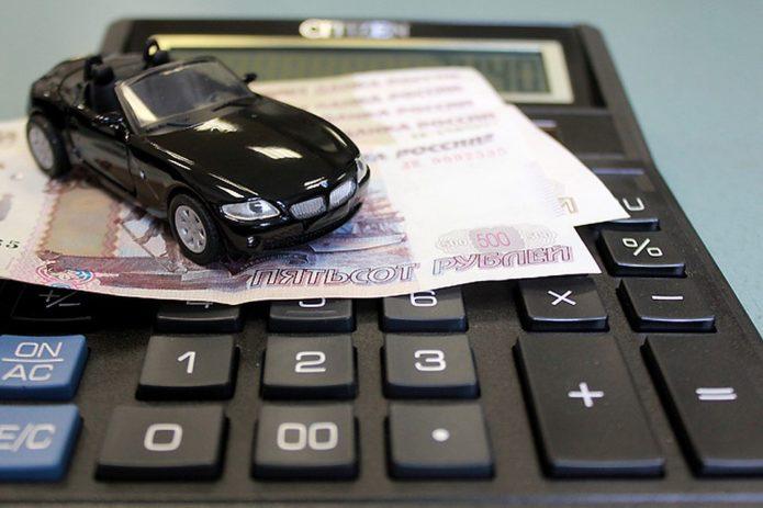 Машинка на калькуляторе и деньгах