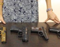 Травматическое оружие на столе перед женщиной